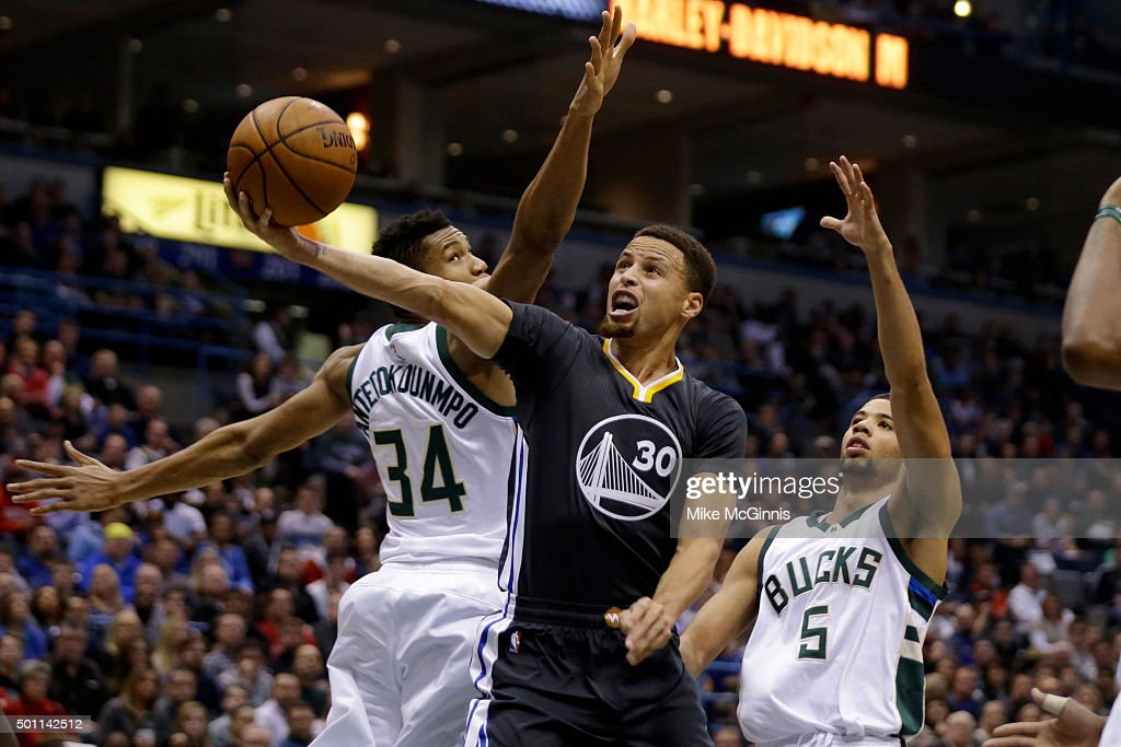 <a gi-track='captionPersonalityLinkClicked' href=/galleries/search?phrase=Stephen+Curry+-+Basketball+Player&family=editorial&specificpeople=5040623 ng-click='$event.stopPropagation()'>Stephen Curry</a> #30 of the Golden State Warriors drives to the hoop for two points during the first quarter against the Milwaukee Bucks at BMO Harris Bradley Center on December 12, 2015 in Milwaukee, Wisconsin.