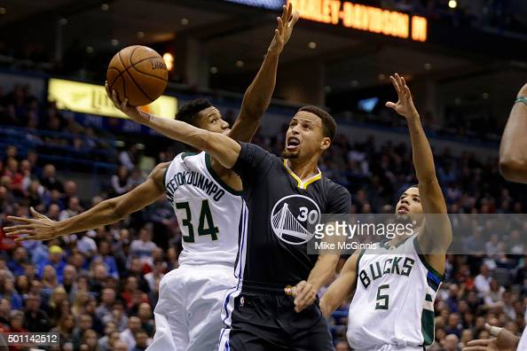 Stephen Curry of the Golden State Warriors drives to the hoop for two points during the first quarter against the Milwaukee Bucks at BMO Harris...