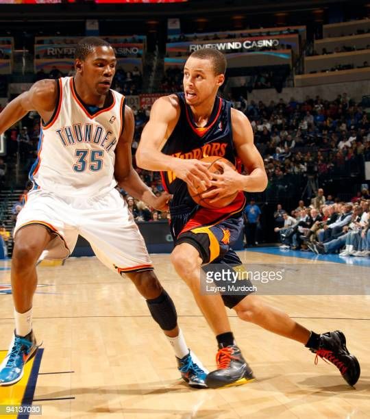 Stephen Curry of the Golden State Warriors drives toward the basket against Kevin Durant of the Oklahoma City Thunder on December 7 2009 at the Ford...