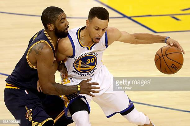 Stephen Curry of the Golden State Warriors drives with the ball against Kyrie Irving of the Cleveland Cavaliers in Game 2 of the 2016 NBA Finals at...