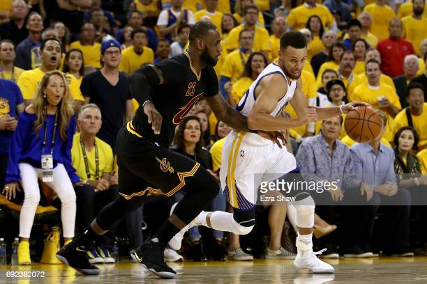 Stephen Curry of the Golden State Warriors drives with the ball against LeBron James of the Cleveland Cavaliers Game 2 of the 2017 NBA Finals at...
