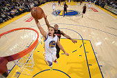Stephen Curry of the Golden State Warriors dunks against the Toronto Raptors on January 2 2015 at Oracle Arena in Oakland California NOTE TO USER...