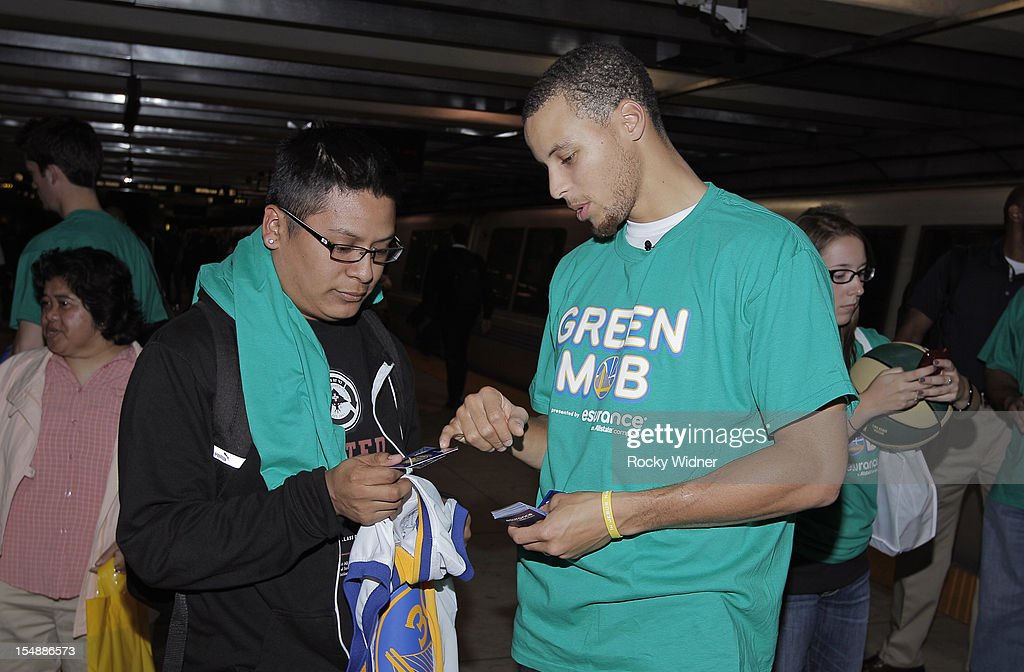Stephen Curry of the Golden State Warriors explains the Clipper card given to a fan on October 26, 2012 in Oakland, California.
