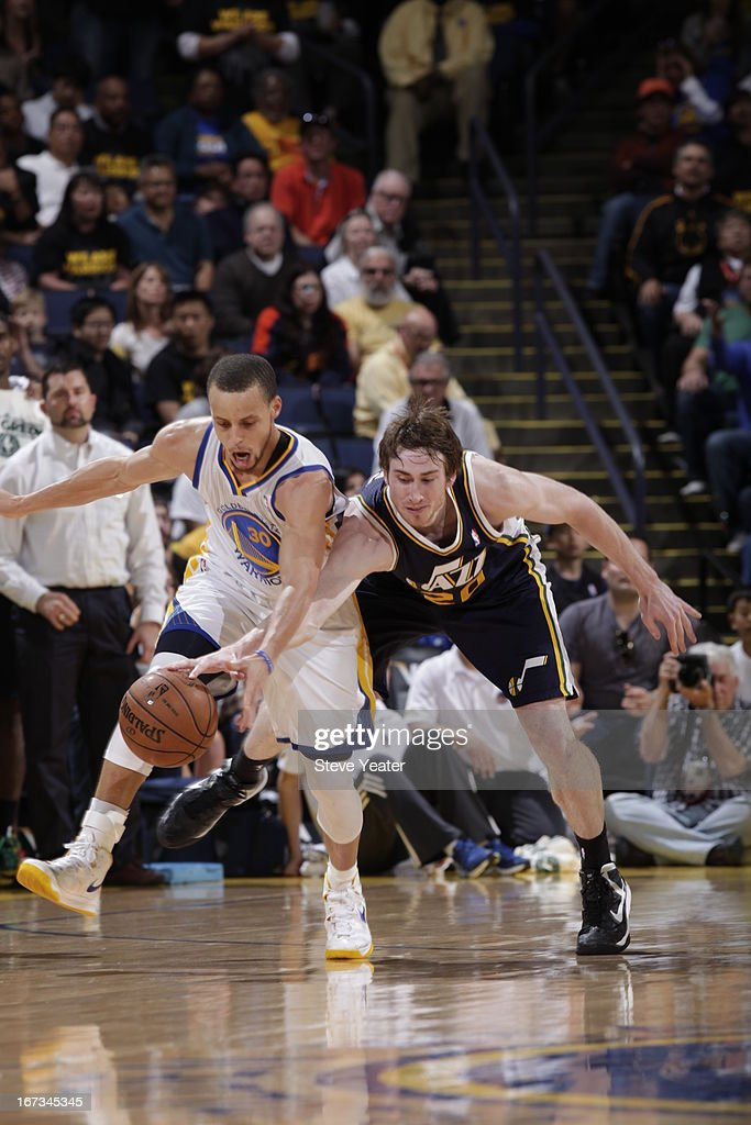 Stephen Curry #30 of the Golden State Warriors fights for the loose ball against <a gi-track='captionPersonalityLinkClicked' href=/galleries/search?phrase=Gordon+Hayward&family=editorial&specificpeople=5767271 ng-click='$event.stopPropagation()'>Gordon Hayward</a> #20 the Utah Jazz on April 7, 2013 at Oracle Arena in Oakland, California.