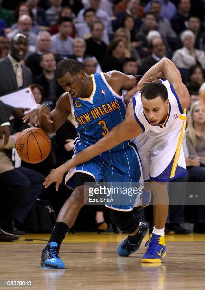 Stephen Curry of the Golden State Warriors fouls Chris Paul of the New Orleans Hornets at Oracle Arena on January 26 2011 in Oakland California NOTE...