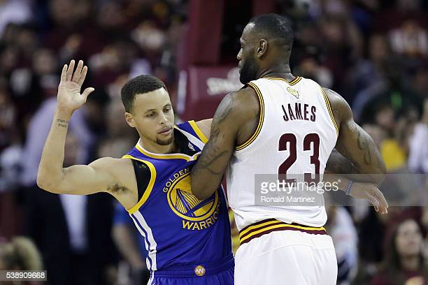 Stephen Curry of the Golden State Warriors gets tangled with LeBron James of the Cleveland Cavaliers during the first half in Game 3 of the 2016 NBA...