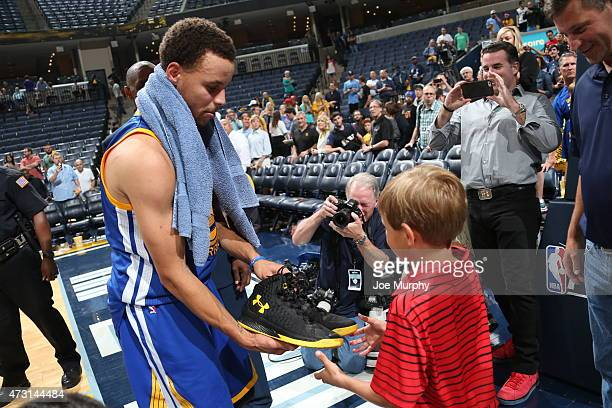 Stephen Curry of the Golden State Warriors gives a fan his game shoes after Game Four of the Western Conference Semifinals against the Memphis...