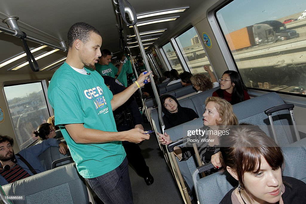Stephen Curry of the Golden State Warriors gives a free Clipper card to a fan on October 26, 2012 in Oakland, California.