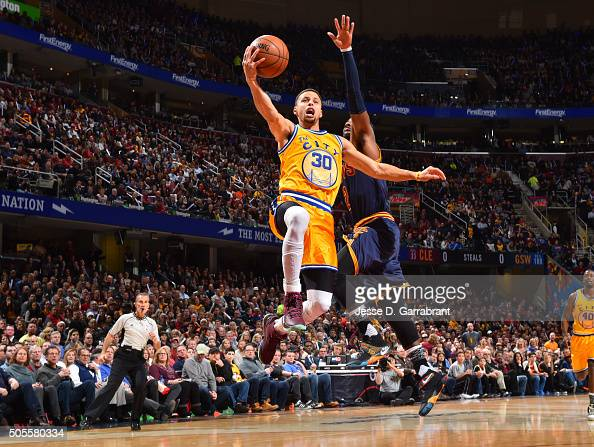Stephen Curry of the Golden State Warriors glides through the air against the Cleveland Cavaliers on January 16 2016 at Quicken Loans Arena in...