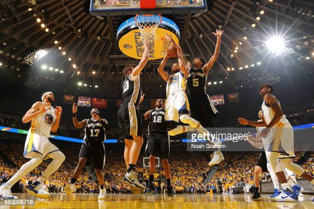 Stephen Curry of the Golden State Warriors goes for a lay up during the game against the San Antonio Spurs during Game One of the Western Conference...