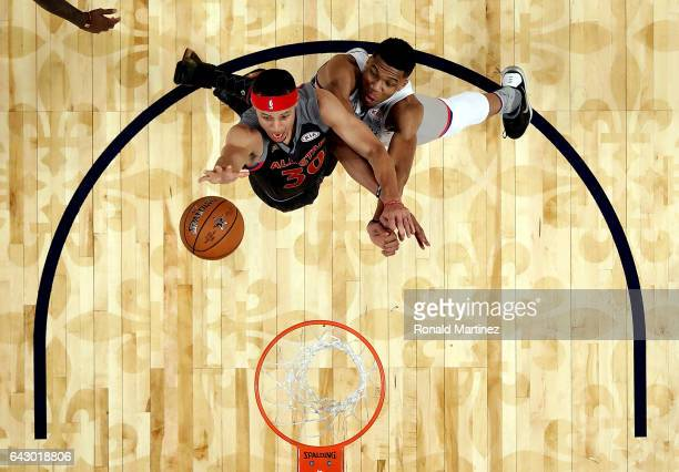 Stephen Curry of the Golden State Warriors goes for a slam dunk against Giannis Antetokounmpo of the Milwaukee Bucks during 2017 NBA AllStar Game at...