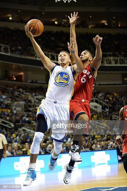 Stephen Curry of the Golden State Warriors goes for the layup against Cory Joseph of the Toronto Raptors during the preseason game on October 5 2015...