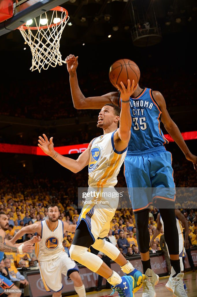 <a gi-track='captionPersonalityLinkClicked' href=/galleries/search?phrase=Stephen+Curry+-+Basketball+Player&family=editorial&specificpeople=5040623 ng-click='$event.stopPropagation()'>Stephen Curry</a> #30 of the Golden State Warriors goes for the lay up against the Oklahoma City Thunder during Game Five of the Western Conference Finals during the 2016 NBA Playoffs on May 26, 2016 at ORACLE Arena in Oakland, California.