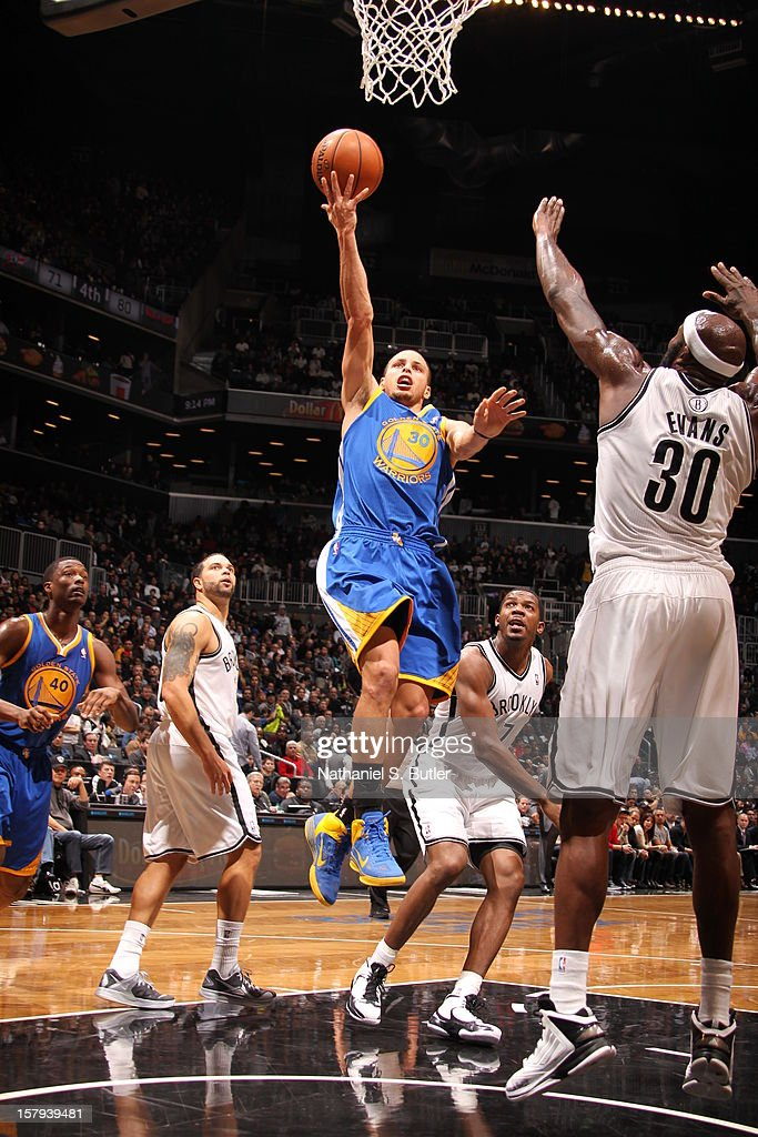 Stephen Curry #30 of the Golden State Warriors goes to the basket against <a gi-track='captionPersonalityLinkClicked' href=/galleries/search?phrase=Reggie+Evans&family=editorial&specificpeople=202254 ng-click='$event.stopPropagation()'>Reggie Evans</a> #30 of the Brooklyn Nets on December 7, 2012 at the Barclays Center in the Brooklyn Borough of New York City.