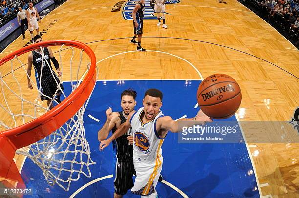 Stephen Curry of the Golden State Warriors goes to the basket against the Orlando Magic on February 25 2016 at Amway Center in Orlando Florida NOTE...