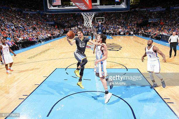 Stephen Curry of the Golden State Warriors goes to the basket against Steven Adams of the Oklahoma City Thunder on February 27 2016 at Chesapeake...