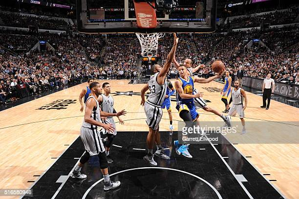 Stephen Curry of the Golden State Warriors goes to the basket against the San Antonio Spurs on March 19 2016 at the ATT Center in San Antonio Texas...