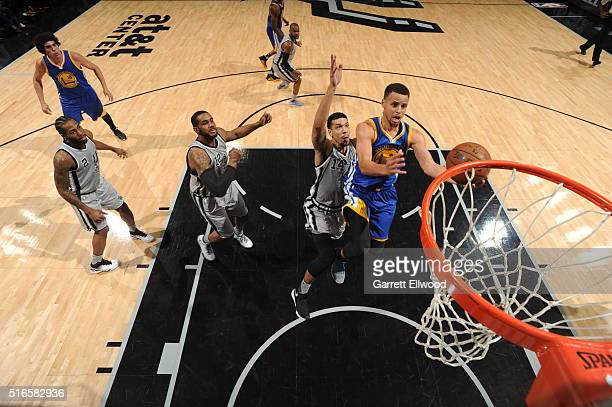 Stephen Curry of the Golden State Warriors goes to the basket against Danny Green of the San Antonio Spurs on March 19 2016 at the ATT Center in San...