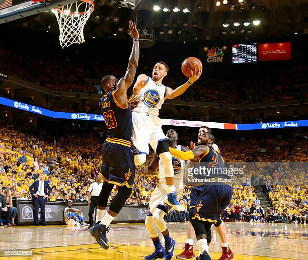 Stephen Curry of the Golden State Warriors goes to the basket against LeBron James of the Cleveland Cavaliers in Game Two of the 2016 NBA Finals on...