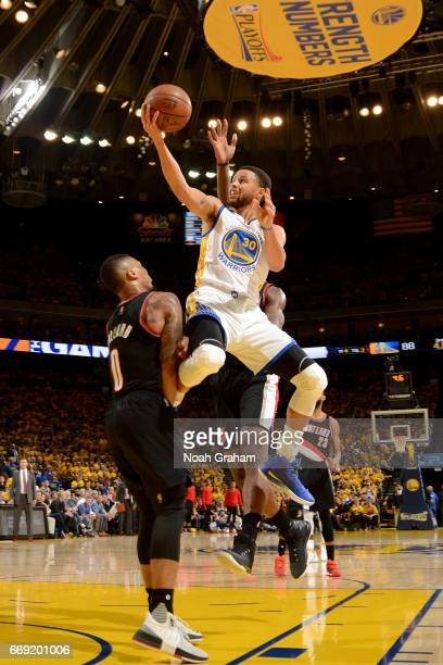 Stephen Curry of the Golden State Warriors goes to the basket against the Portland Trail Blazers during the Western Conference Quarterfinals of the...
