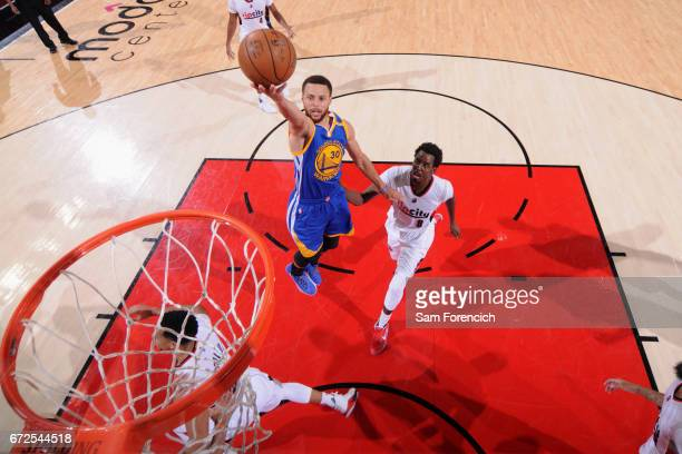 Stephen Curry of the Golden State Warriors goes to the basket against the Portland Trail Blazers during Game Four of the Western Conference...