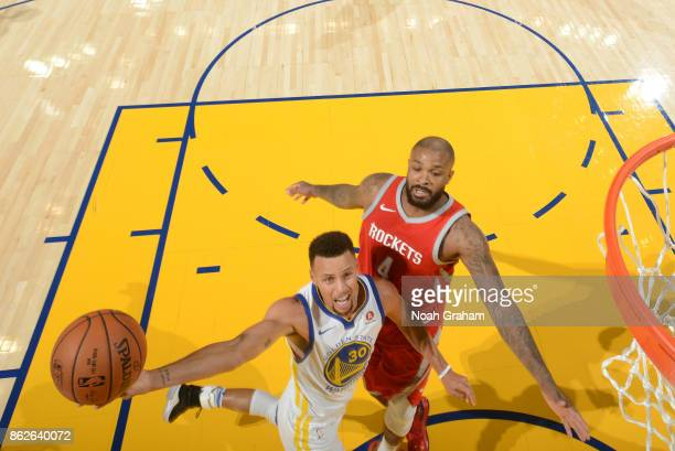 Stephen Curry of the Golden State Warriors goes to the basket against the Houston Rockets on October 17 2017 at ORACLE Arena in Oakland California...