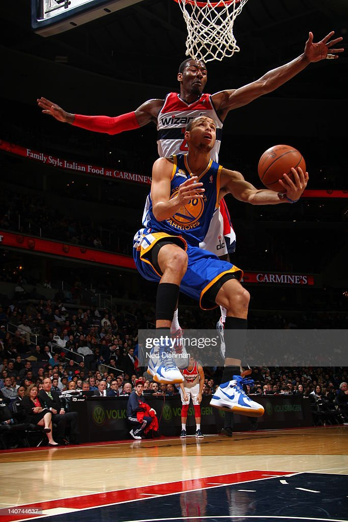 Stephen Curry #30 of the Golden State Warriors goes to the basket as <a gi-track='captionPersonalityLinkClicked' href=/galleries/search?phrase=John+Wall&family=editorial&specificpeople=2265812 ng-click='$event.stopPropagation()'>John Wall</a> #2 of the Washington Wizards blocks during the game between the Washington Wizards and the Golden State Warriors at the Verizon Center on March 5, 2012 in Washington, DC.
