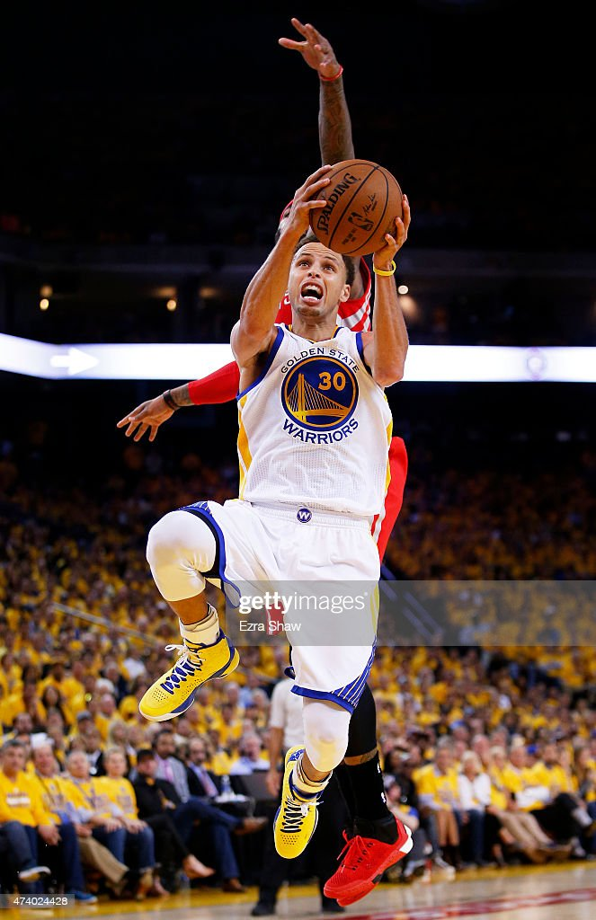 Stephen Curry #30 of the Golden State Warriors goes up against Josh Smith #5 of the Houston Rockets in the fourth quarter during Game One of the Western Conference Finals of the 2015 NBA Playoffs at ORACLE Arena on May 19, 2015 in Oakland, California.