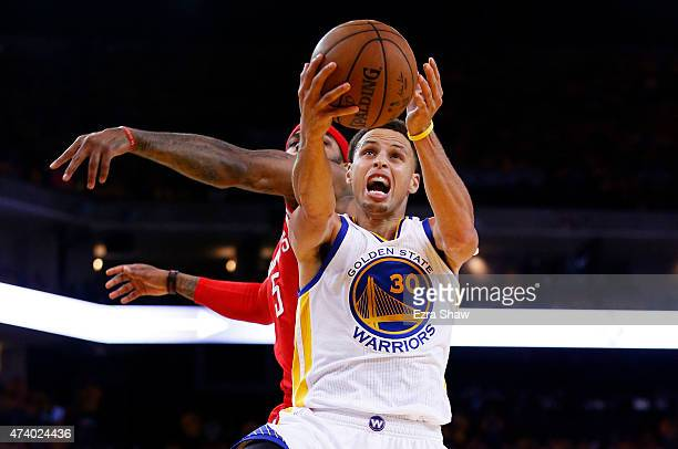 Stephen Curry of the Golden State Warriors goes up against Josh Smith of the Houston Rockets in the fourth quarter during Game One of the Western...