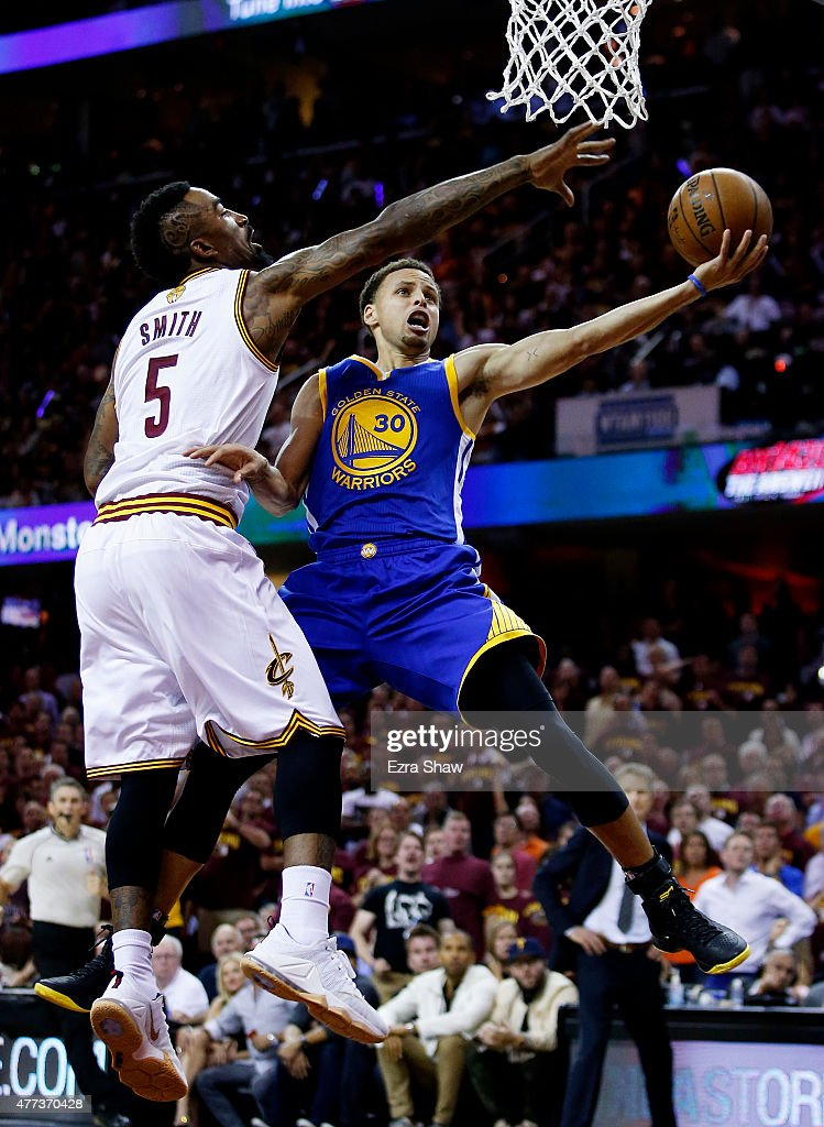 Stephen Curry #30 of the Golden State Warriors goes up against J.R. Smith #5 of the Cleveland Cavaliers in the second quarter during Game Six of the 2015 NBA Finals at Quicken Loans Arena on June 16, 2015 in Cleveland, Ohio.