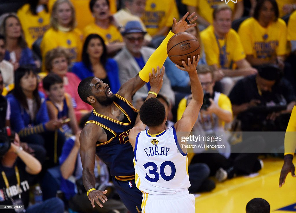 Stephen Curry #30 of the Golden State Warriors goes up against Kyrie Irving #2 of the Cleveland Cavaliers in the first quarter during Game One of the 2015 NBA Finals at ORACLE Arena on June 4, 2015 in Oakland, California.