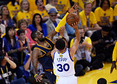 Stephen Curry of the Golden State Warriors goes up against Kyrie Irving of the Cleveland Cavaliers in the first quarter during Game One of the 2015...