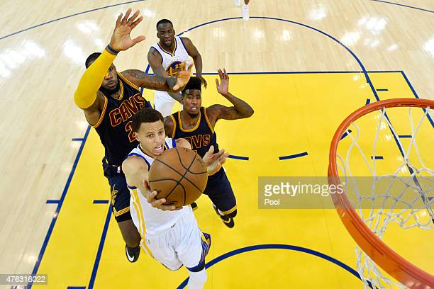 Stephen Curry of the Golden State Warriors goes up against LeBron James of the Cleveland Cavaliers in the second half during Game Two of the 2015 NBA...