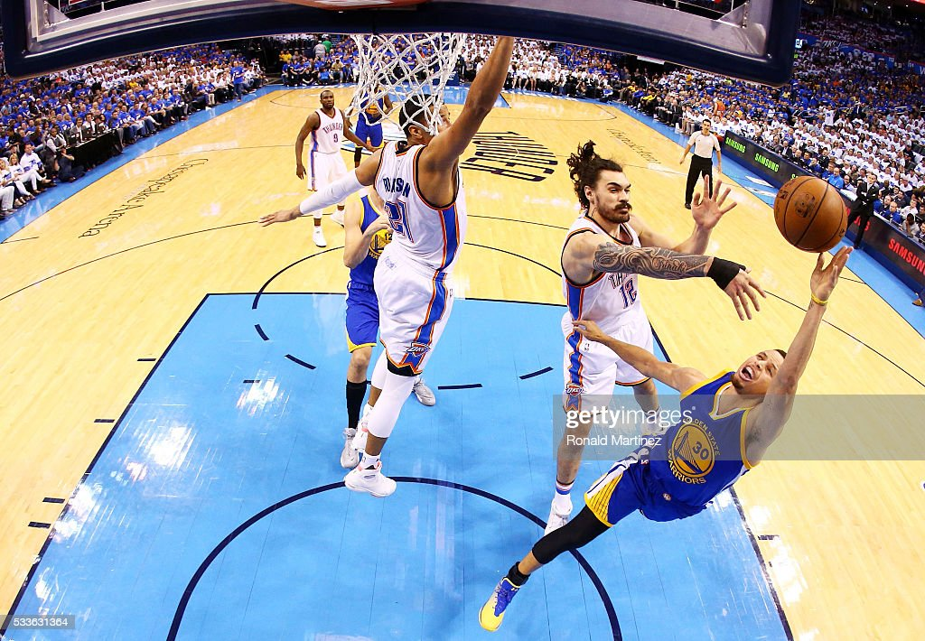 Stephen Curry #30 of the Golden State Warriors goes up against Steven Adams #12 of the Oklahoma City Thunder in game three of the Western Conference Finals during the 2016 NBA Playoffs at Chesapeake Energy Arena on May 22, 2016 in Oklahoma City, Oklahoma.