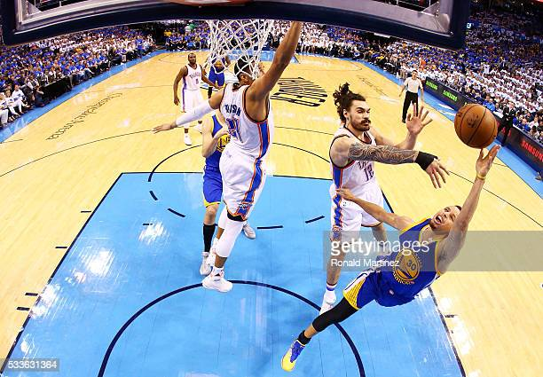 Stephen Curry of the Golden State Warriors goes up against Steven Adams of the Oklahoma City Thunder in game three of the Western Conference Finals...