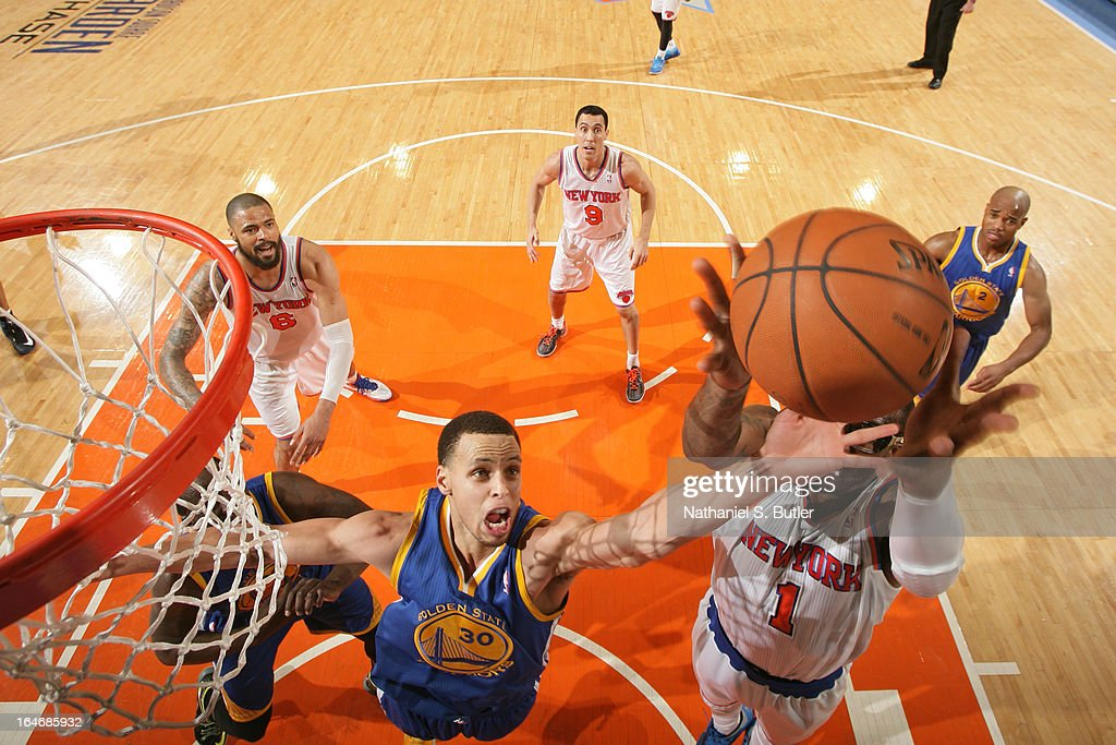 Stephen Curry #30 of the Golden State Warriors goes up for a rebound against the New York Knicks on February 27, 2013 at Madison Square Garden in New York City.