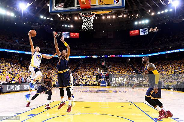 Stephen Curry of the Golden State Warriors goes up for a shot against Channing Frye of the Cleveland Cavaliers in the first half in Game 1 of the...