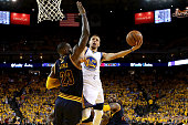 Stephen Curry of the Golden State Warriors goes up for a shot against LeBron James of the Cleveland Cavaliers in the first half in Game 2 of the 2016...