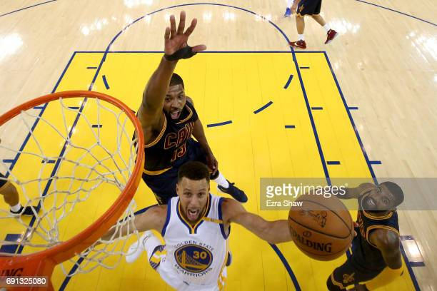 Stephen Curry of the Golden State Warriors goes up for a shot against Tristan Thompson of the Cleveland Cavaliers in Game 1 of the 2017 NBA Finals at...