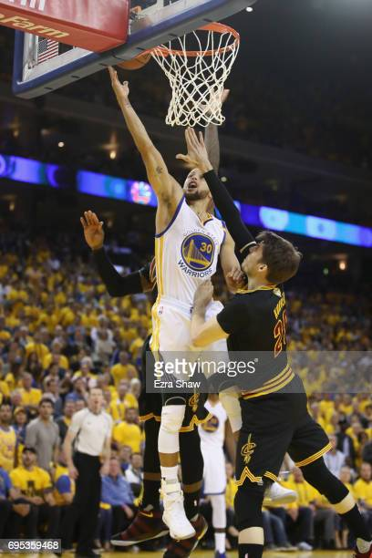 Stephen Curry of the Golden State Warriors goes up for a shot against Kyle Korver of the Cleveland Cavaliers in Game 5 of the 2017 NBA Finals at...