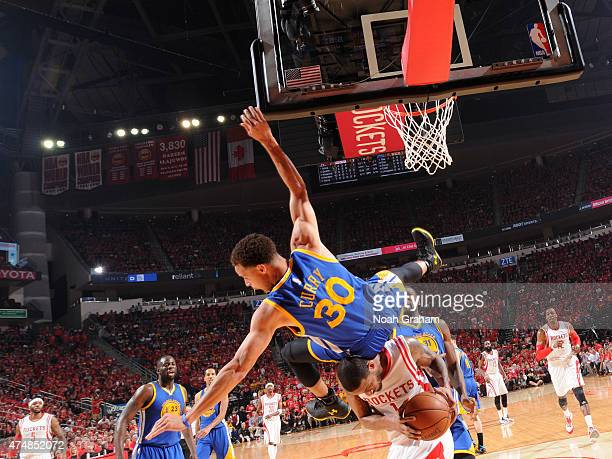 Stephen Curry of the Golden State Warriors goes up to block a shot and takes a hard fall against the Houston Rockets during the Western Conference...