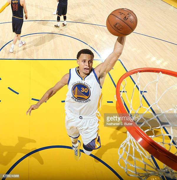 Stephen Curry of the Golden State Warriors goes up to dunk during Game One of the 2015 NBA Finals on June 4 2015 at Oracle Arena in Oakland...
