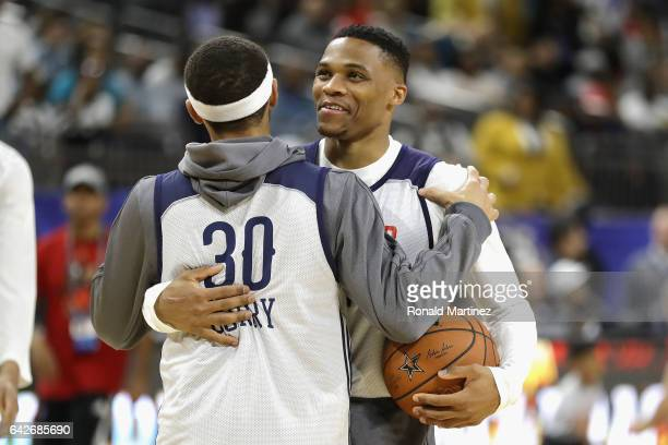 Stephen Curry of the Golden State Warriors greets Russell Westbrook of the Oklahoma City Thunder during practice for the 2017 NBA AllStar Game at the...