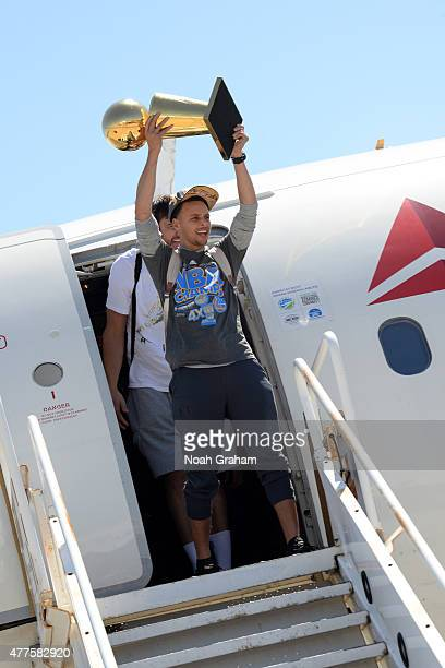 Stephen Curry of the Golden State Warriors greets the fans of the Golden State Warriors as the team arrives home from Cleveland after winning the...