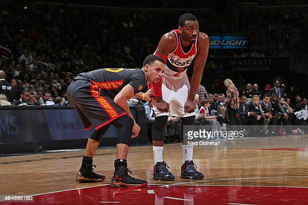 Stephen Curry of the Golden State Warriors guards his position against John Wall of the Washington Wizards at the Verizon Center on February 24 2015...