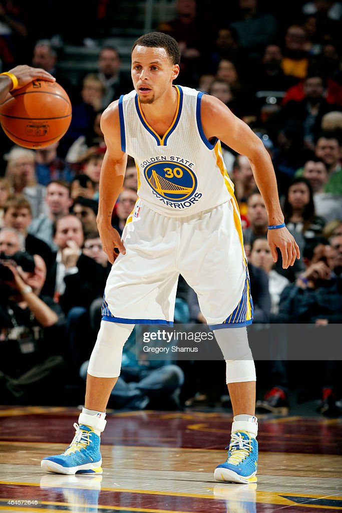 <a gi-track='captionPersonalityLinkClicked' href=/galleries/search?phrase=Stephen+Curry+-+Basketball+Player&family=editorial&specificpeople=5040623 ng-click='$event.stopPropagation()'>Stephen Curry</a> #30 of the Golden State Warriors guards his position against the Cleveland Cavaliers at The Quicken Loans Arena on February 26, 2015 in Cleveland, Ohio.