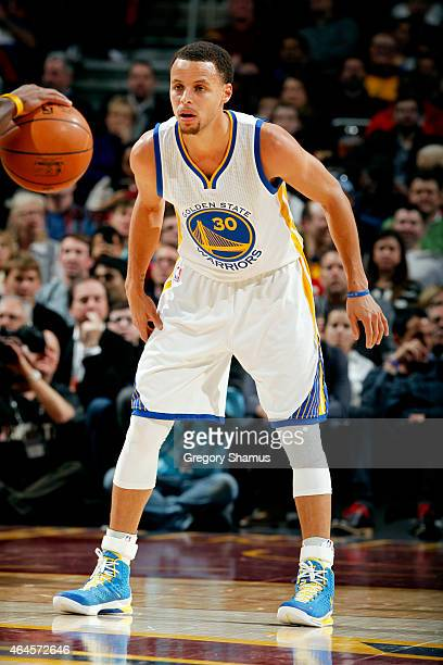 Stephen Curry of the Golden State Warriors guards his position against the Cleveland Cavaliers at The Quicken Loans Arena on February 26 2015 in...
