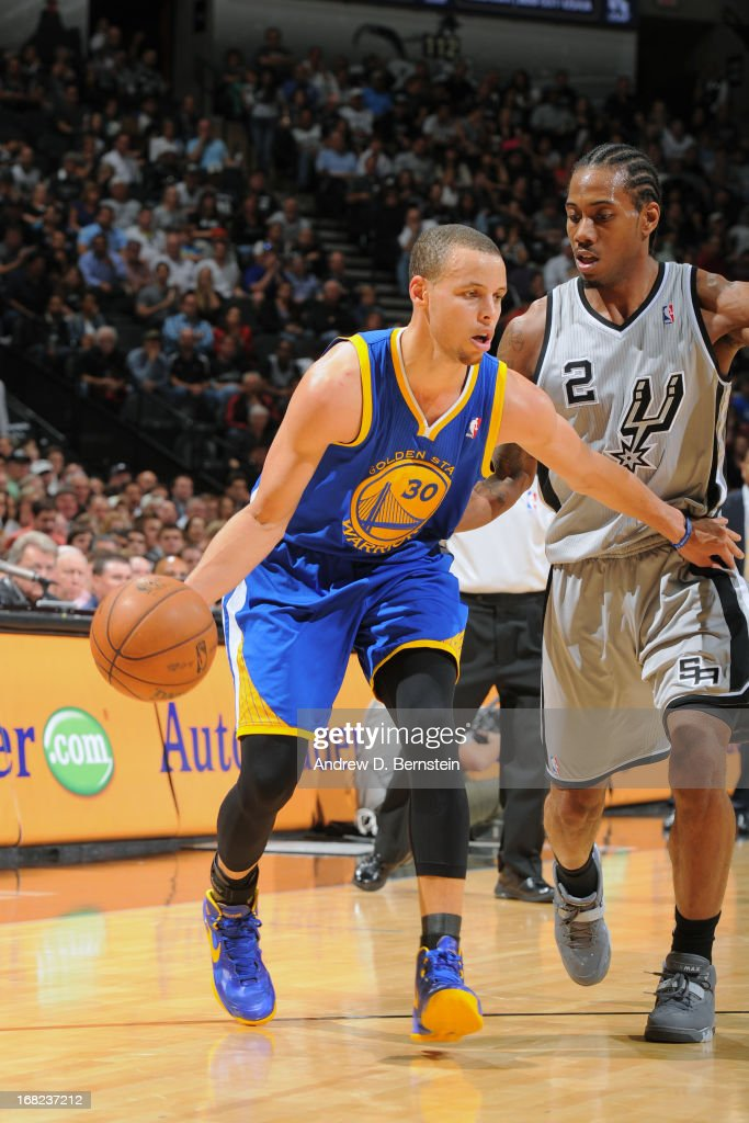Stephen Curry #30 of the Golden State Warriors handles the ball against Kawhi Leonard #2 of the San Antonio Spurs in Game One of the Western Conference Semifinals during the 2013 NBA Playoffs on May 6, 2013 at the AT&T Center in San Antonio, Texas.