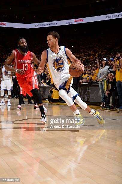 Stephen Curry of the Golden State Warriors handles the ball against James Harden of the Houston Rockets in Game Five of the Western Conference Finals...