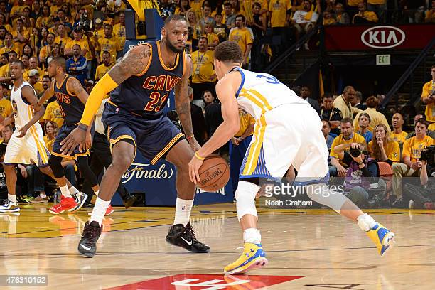 Stephen Curry of the Golden State Warriors handles the ball against LeBron James of the Cleveland Cavaliers in Game Two of the 2015 NBA Finals on...